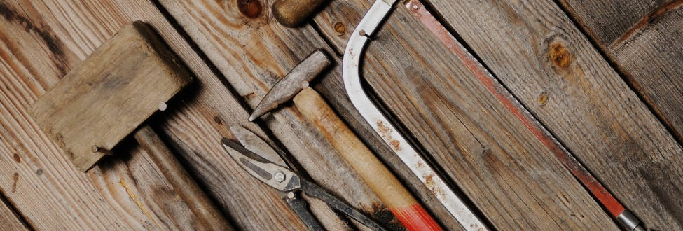 A line up of tools from new to old to show evolution of tools